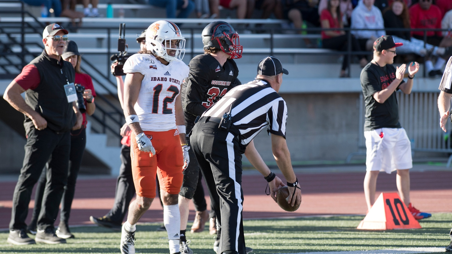 Idaho State defender looks on as SUU scores